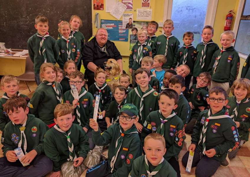 1st Haverhill Cubs get a visit from Parsley the Guide Dog and his owner, Simon Edwards.