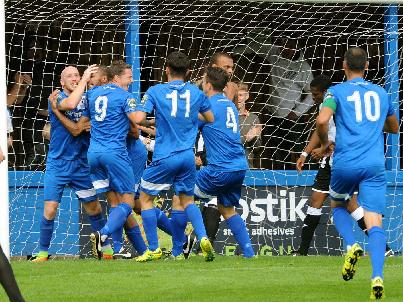 Bury Town players congratulate Leon Ottley-Gooch on putting the Blues 2-0 up against Tilbury Picture: Andy Abbott