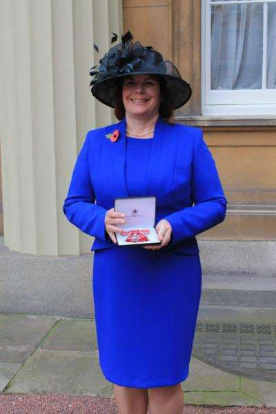 Sarah Howard after receiving her MBE from the Queen at Buckingham Palace ANL-151111-095320001