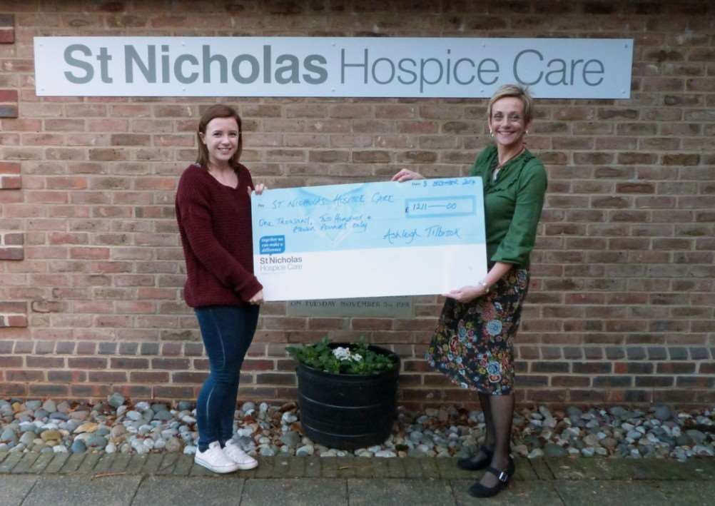 Ashleigh Tilbrook (left) who raised more than ?1,200 for St Nicholas Hospice Care, presenting a cheque to hospice events and challenges fund-raiser Jenny Baskett ANL-141218-140949001