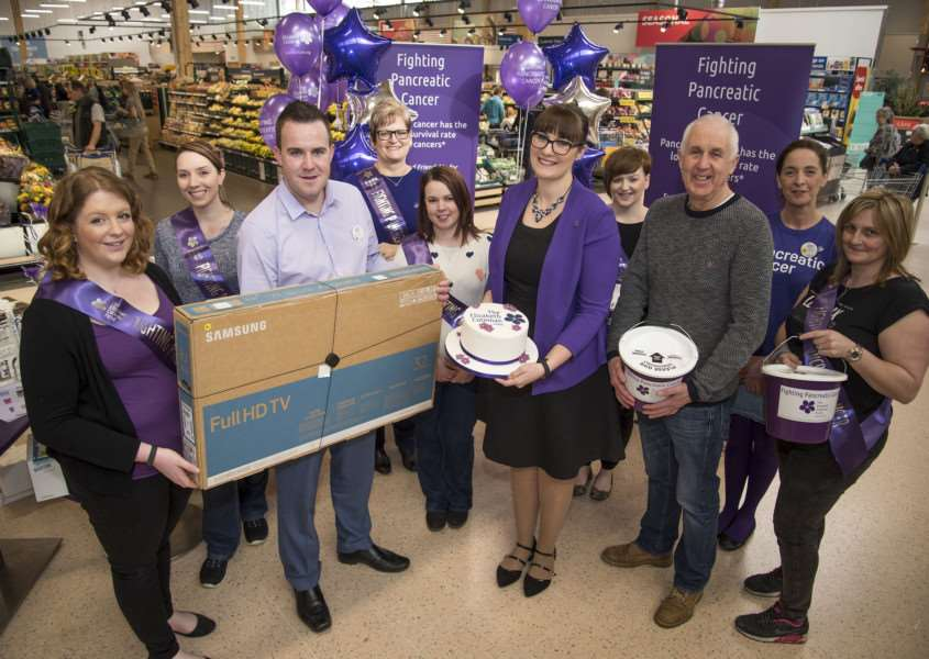 Tesco, Newmarket Julie Wilcock holding fundraising event to raise money for the Elizabeth Coteman fund which helps families and raised awareness of pancreatic cancer, Julie pictured with Gerald Coteman, head of charity and Store manager Alistair Thomson and helpers on Satuday.'Picture Mark Westley