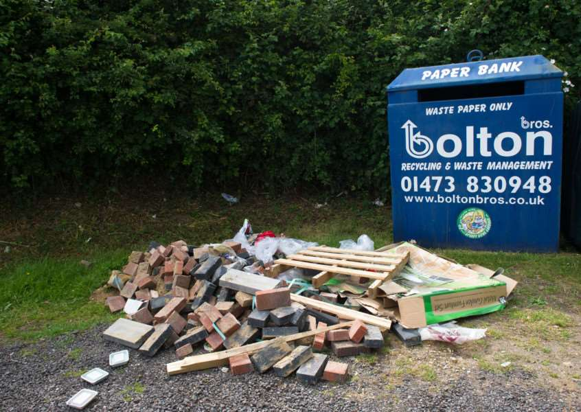 Fly tipping (including bones) left by the recycling bins at the Village hall in Newton ANL-150615-193820009