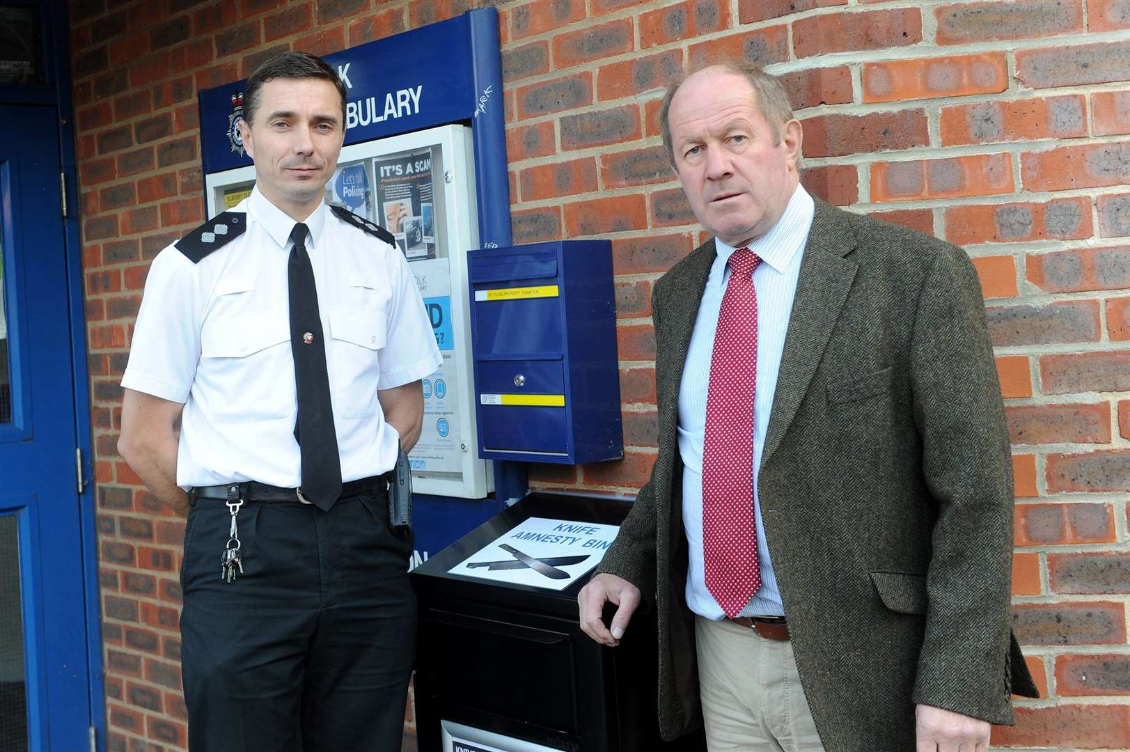 Haverhill Police Inspector Danny Cooper and Suffolk Police Crime Commissioner Tim Passmore next to the knife amnesty bin outside Haverhill Police Station. Picture by Mecha Morton.