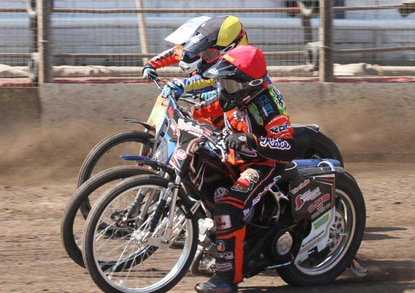 CONFIDENT MOOD: Captain Jon Armstrong (red) in action against Eastbourne Eagles. Picture: Derek Leader
