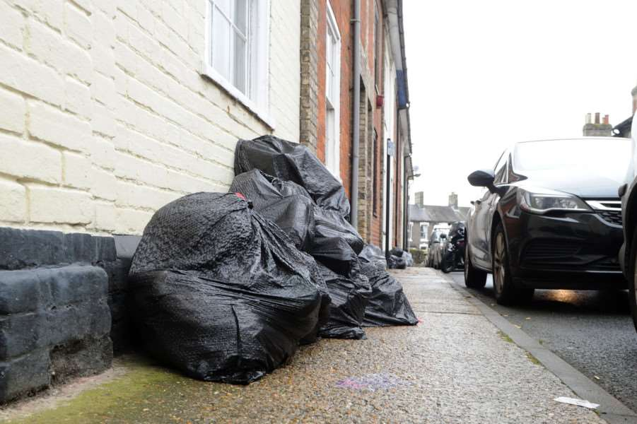 Black bins in Bury St Edmunds were collected on Saturday without anyone knowing. They are now piled up on the streets''Pictured: St Johns Place''''PICTURE: Mecha Morton