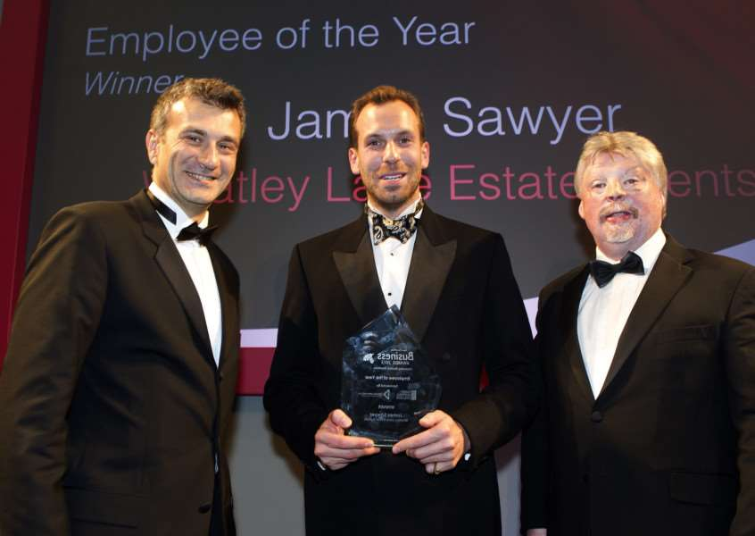 WSC's Nikos Savvas presents the Employee of the Year Award 2015 to James Sawyer, watched by Simon Weston ANL-151010-020214009