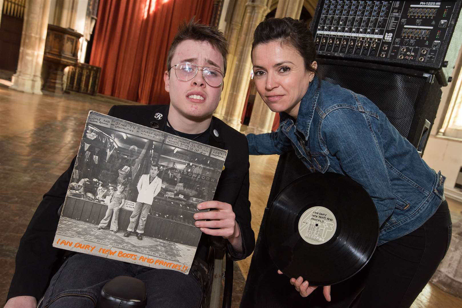 15-year-old Dylan Barton from Sible Hedingham with Gemma Mackman and a copy of his favourite vinyl album by Ian Drury which is being introduced and played at St Peter's for Record Day. The event is to raise money for The Bridge Project.. Picture by Mark Westley. (8407674)