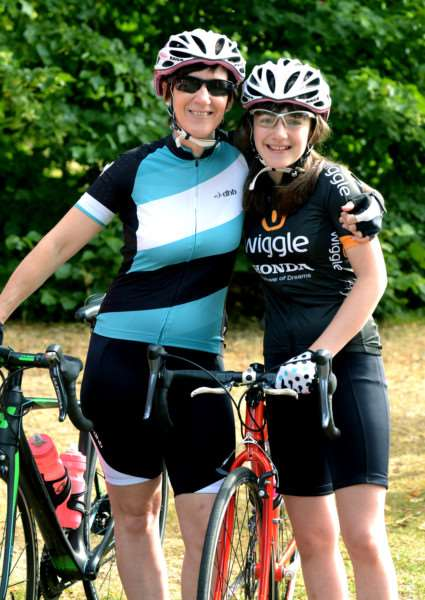 The 100th member of the Bury Bicycle Collective (BBC) Martha Lebentz (right) with her mother and co-founder of the BBC Amelia Richardson (left). Martha joins the BBC as the date for Women on Wheels Bury St Edmunds 2016 is announced. ANL-160602-161250001