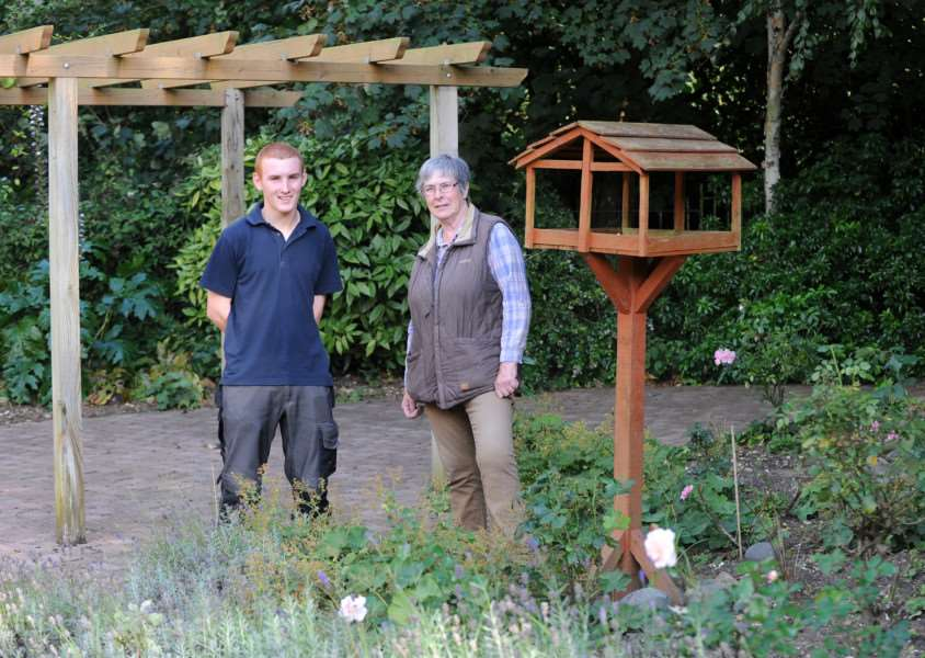 Chris Wiley and volunteer Mary Chown in the hospice's back garden ANL-140819-182630009