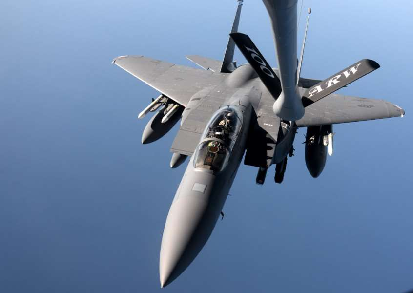 An F-15E Strike Eagle from the 48th Fighter Wing approaches a KC-135 Stratotanker from the 100th Air Refueling Wing for refueling over the northern Mediterranean. (USAF photo by Senior Airman Kate Thornton) ANL-151116-101926001