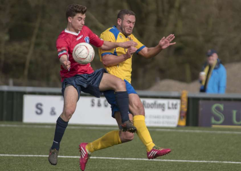 STRONG CHALLENGE: AFC Sudbury's Luke Callander in the thick of the action during their 2-1 win against Wroxham at The Wardale Williams on Saturday, which took them a step closer to the title