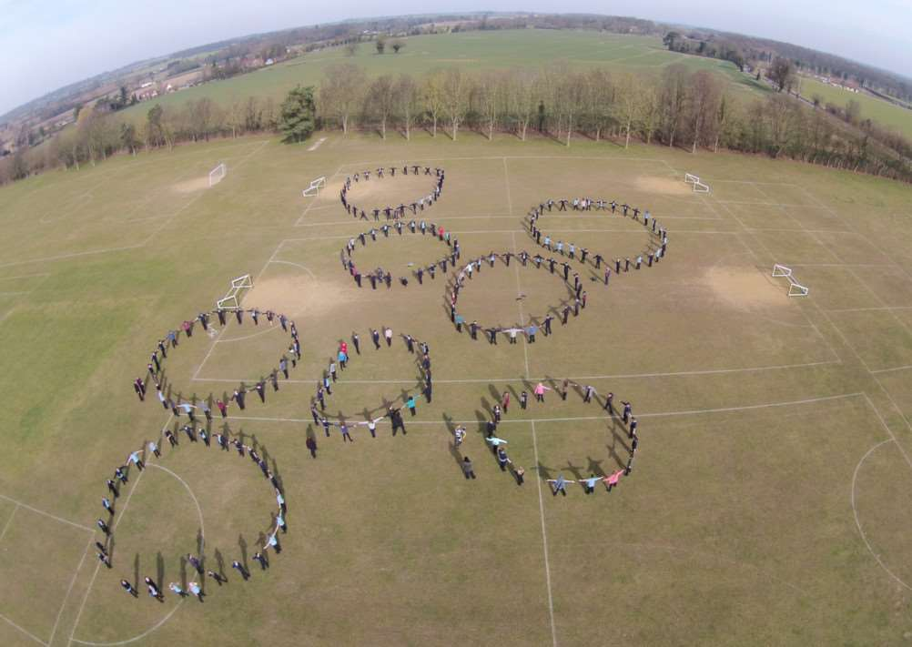 Students at Thurston Community College take part in a Pi exercise by forming human circles ANL-150317-114000001