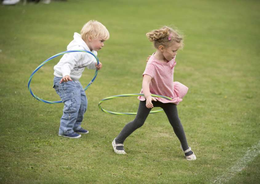 Laurence Millar, 3, and Freja George , 3, take part in the hula-hoop contest