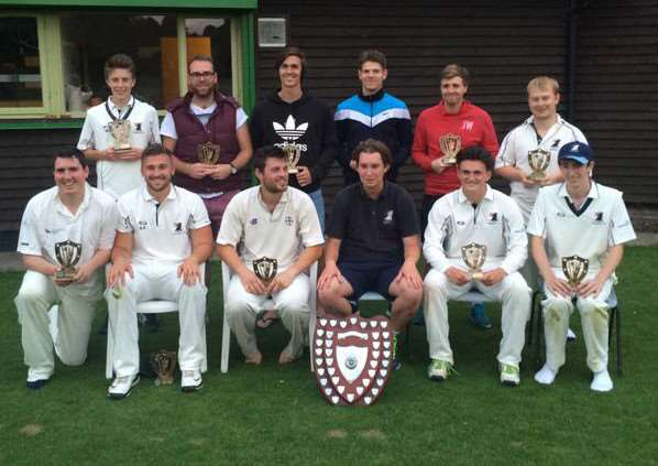 Haverhill's players with their trophies after winning the Adams Harrison Midweek Cricket League Division One title with a six wicket victory at Saffron Walden. Back row, from left: Will Bailey, Sam Powell, Adam Dellar, Dan Pass, Sam Hartshorn, Craig Williams. Front row, from left: James Smith, Alex Archer, Dave Humphrey, Joey Kettle, Callum Brunning, Sam Street. Contributed picture ANL-150716-102033002