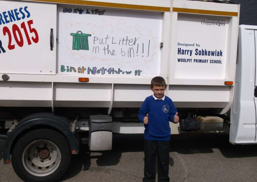 THUMBS UP: Creative nine-year-old Henry Sobkowiak with his winning design emblazoned on the council cleaning truck ANL-150730-151953001