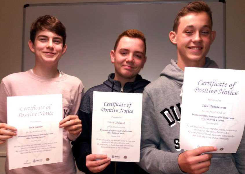 The first youngsters to get Norfolk Police Positive Notices for honourable behaviour, from the left, Jack Austin, Harry Cromwell and Jack Hutcherson from Thetford are presented with their certificates by Insp Becky Cant ANL-160311-094849001