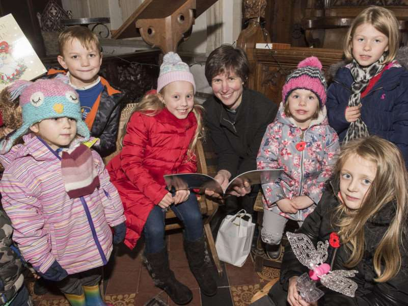 The Rev Eleanor Whalley, priest-in-charge, reading the Christmas story to youngsters at Sohams St Andrews Church at Fridays Christmas fair.
