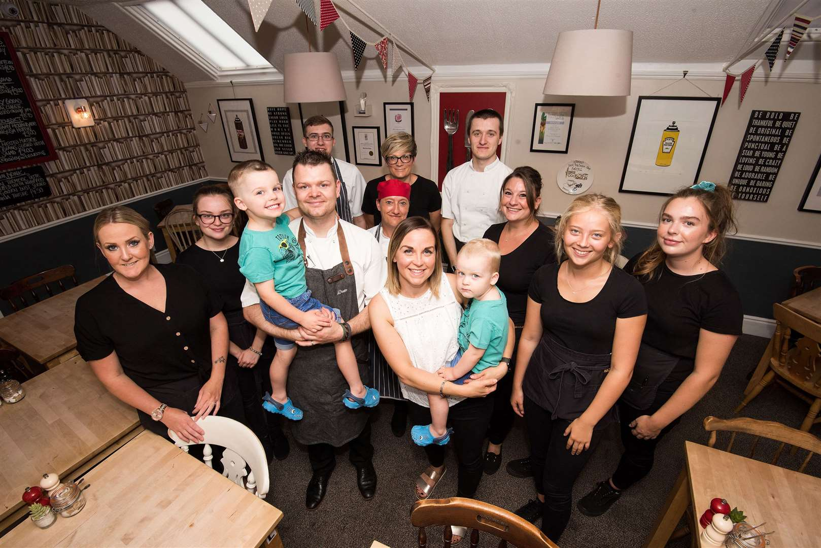 Louise and Dean Foster are celebrating 10 years since they took over the Baileys 2 coffee shop, in Whiting Street. They are pictured with members of staff and their boys Stanley and Archie. Picture: Mark Westley