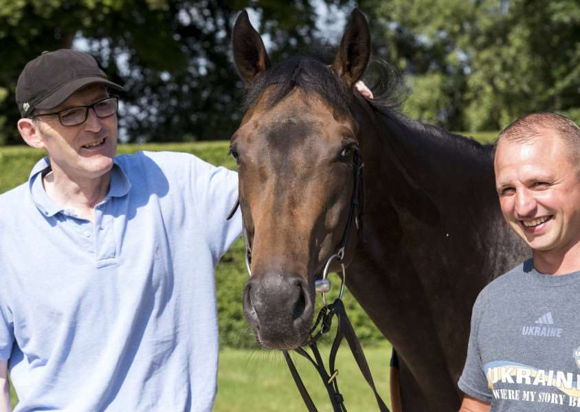 BOUNCING BACK: The Tin Man with James Fanshawe (left) and groom Oleg Sheyhets (right)