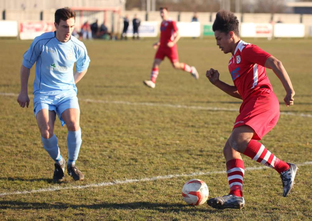 Haverhill Rovers Ty Alleyne tries to get past his marker against Thetford Town