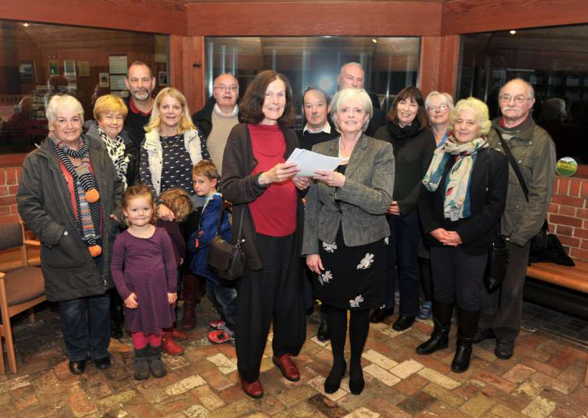 Refugees petition handed over at Babergh District Council. A petition has been running a 38Degrees petition re welcoming Syrian refugees in Pictured: Rosemary Loshak handing over the petition to Cllr Jan Osborne ANL-151028-091610009