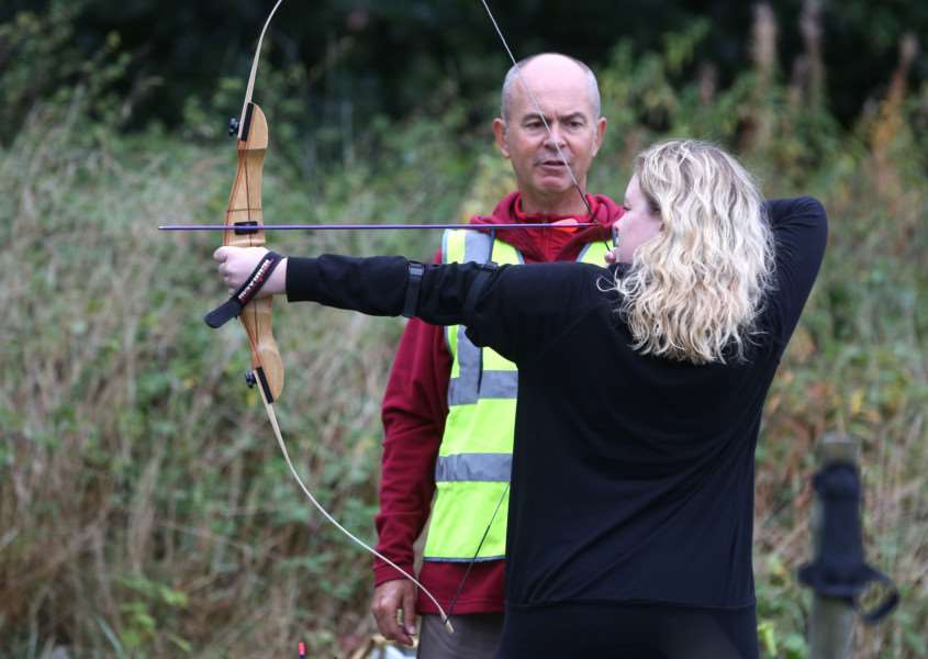 A visitor tries her hand at archery at West Stow Anglo Saxon Village during the Warriors Through Time event. Pic - Richard Marsham ANL-160917-165411009