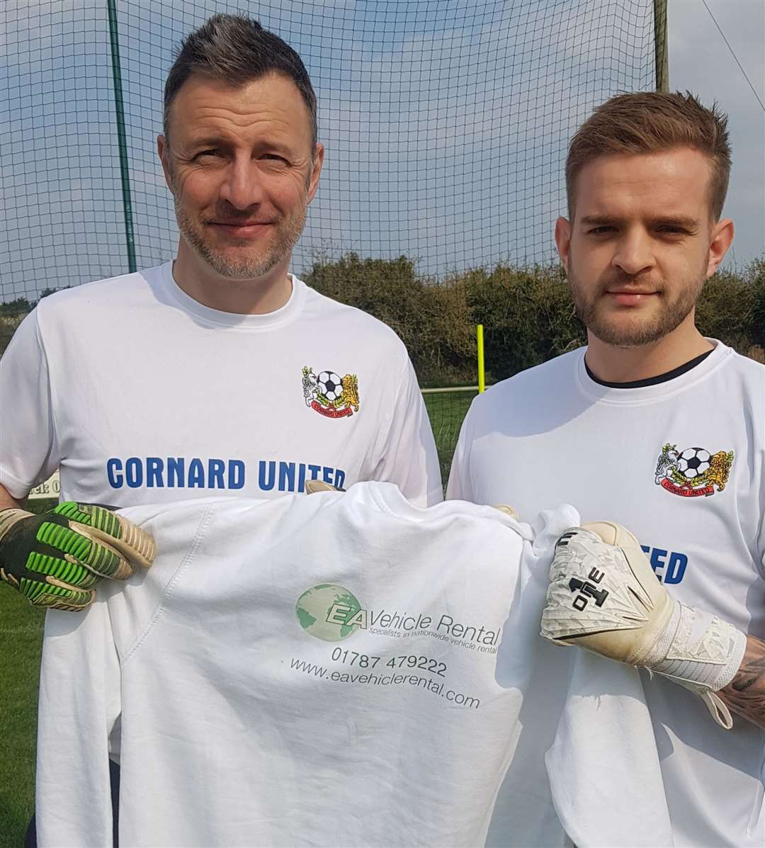 Cornard United goalkeeping coach Colin Athey (left) and goalkeeper and joint-manager Matt Grove with the EA Vehicle Rental training top, after the local company agreed a sponsorship deal with the club ahead of their Suffolk Senior Cup semi-final (9934840)
