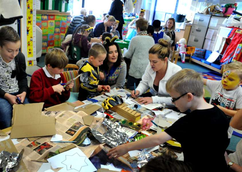 Pupils parents and staff at the Hardwick Primary School taking part in the Recycle for Suffolk project 1000 Suffolk Stars. The whole school with mums, dads and grandparents made a star constructed and designed with recycled and reusable materials. The finished creations to be hung along with those from other schools throughout Suffolk to be hung in a display at the Apex in Bury St Edmunds ANL-151116-081831009