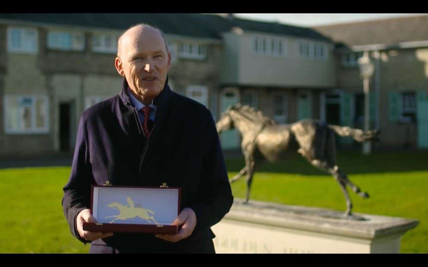 John Gosden accepts his Cartier/Daily Telegraph Award of Merit trophy(43265085)
