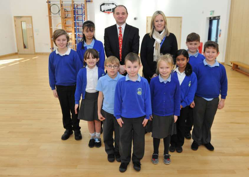 Westfield Primary Academy School head teacher, Nicky Tyler, with pupils and executive principal Darren Woodward