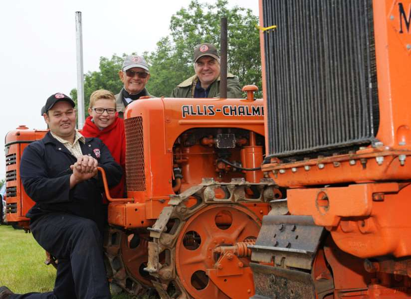 Hockwold Country Fair, ready for the off'LtoR, Matthew Hoy, Harry Rayner, Len Cullen, Dave Buttriss, they are with the Allis Chalmers Crawler, build 1945-46. ANL-150614-174427009