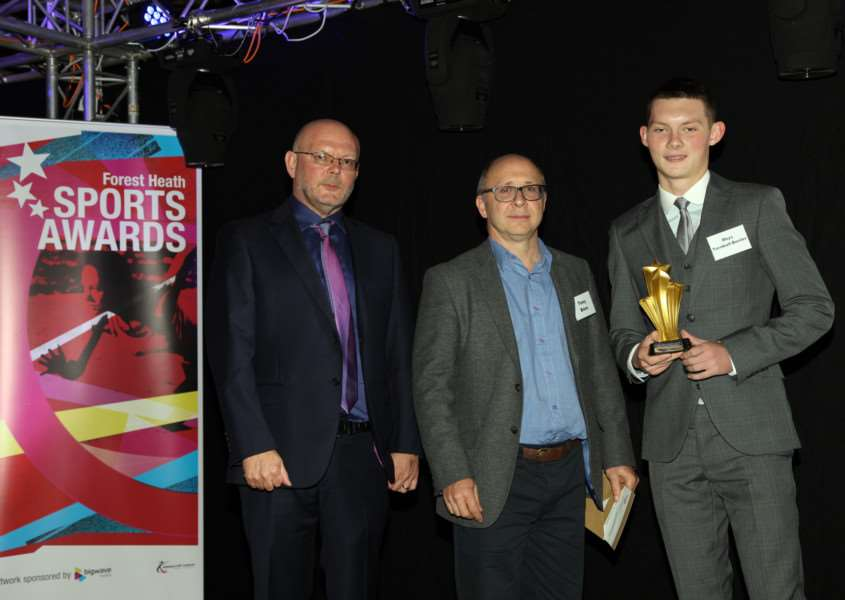 DOUBLE ACCOLADE: Rhys Turnbull-Bester (right) receives his Young Sports Personality of the Year award