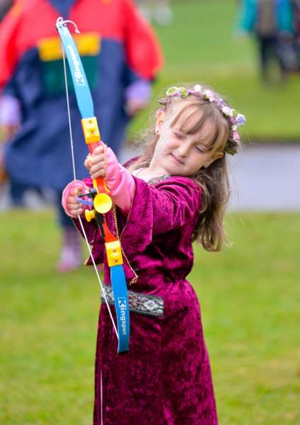 Magna Carter Festival at Clare Country Park. Grace Ebeling (6) takes aim ANL-150614-164947009