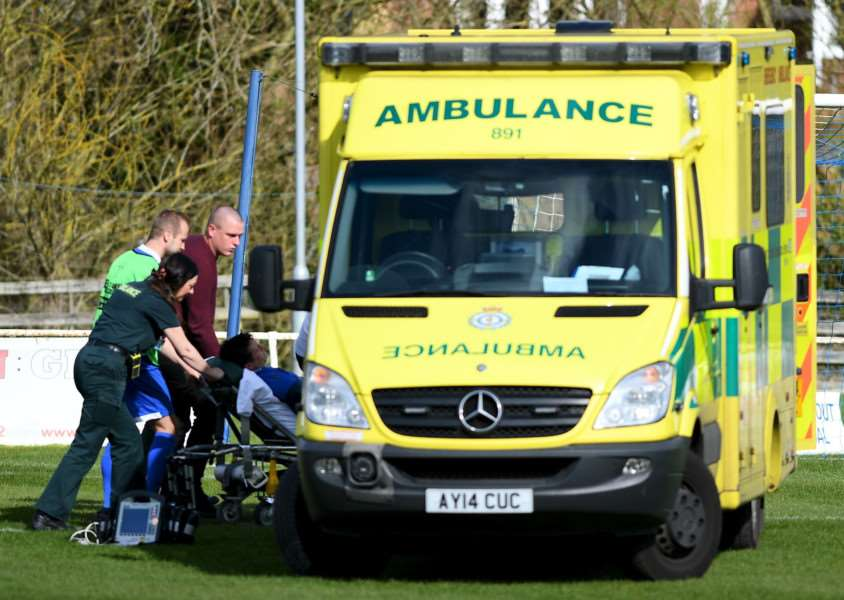 ABANDONED: Lee Hurkett is taken to hospital via an ambulance