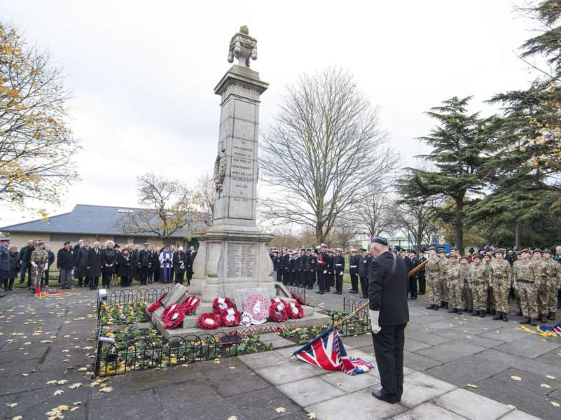 The sombre moment at Newmarket's war memorial the standards are lowered and those who gave their lives remembered