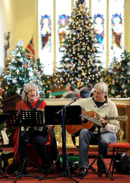 Christmas Tree festival at St Peter and St Marys Church Stowmarket''Pictured: Maggie Moore and Dan Bloor providing some music ANL-161128-081240009