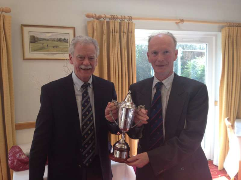 HANDS ON THE CUP: Mike Halliwell, Stowmarket Golf Club's Seniors section outgoing captain, presents The Bayley Trophy to winner Clive George