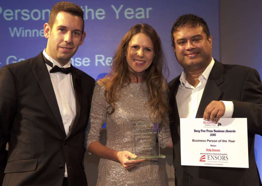 Kelly Dawson receives the Business Person of the Year 2016 award from Chris Barrett,left, and compare Paul Sinha