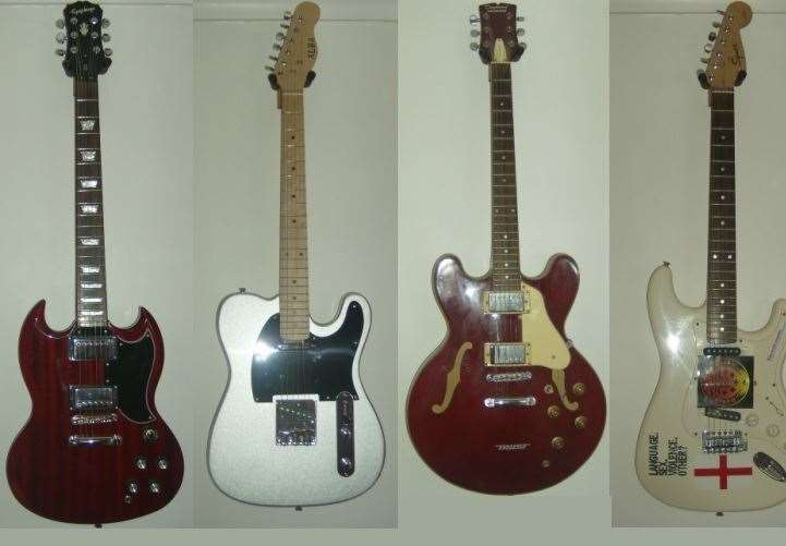 The cherry-coloured Epiphone G-400 pro electric guitar, silver Alba telecaster guitar, red cherry Tanglewood TSB 59 semi-hollow guitar and white Squier Bullet Strat HSS Arctic Fender that were taken in the burglary(22693013)