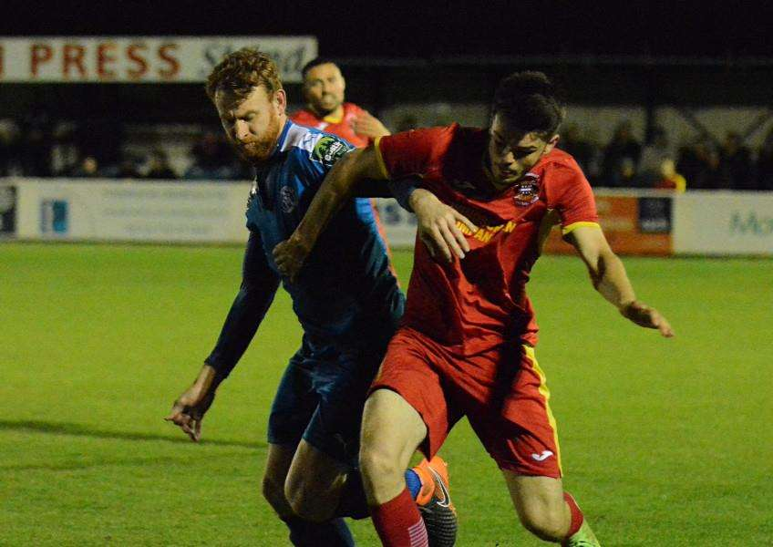 TIRED LEGS: Ryan Gibbs battles for Needham in their third game in six days. Picture: Ben Pooley