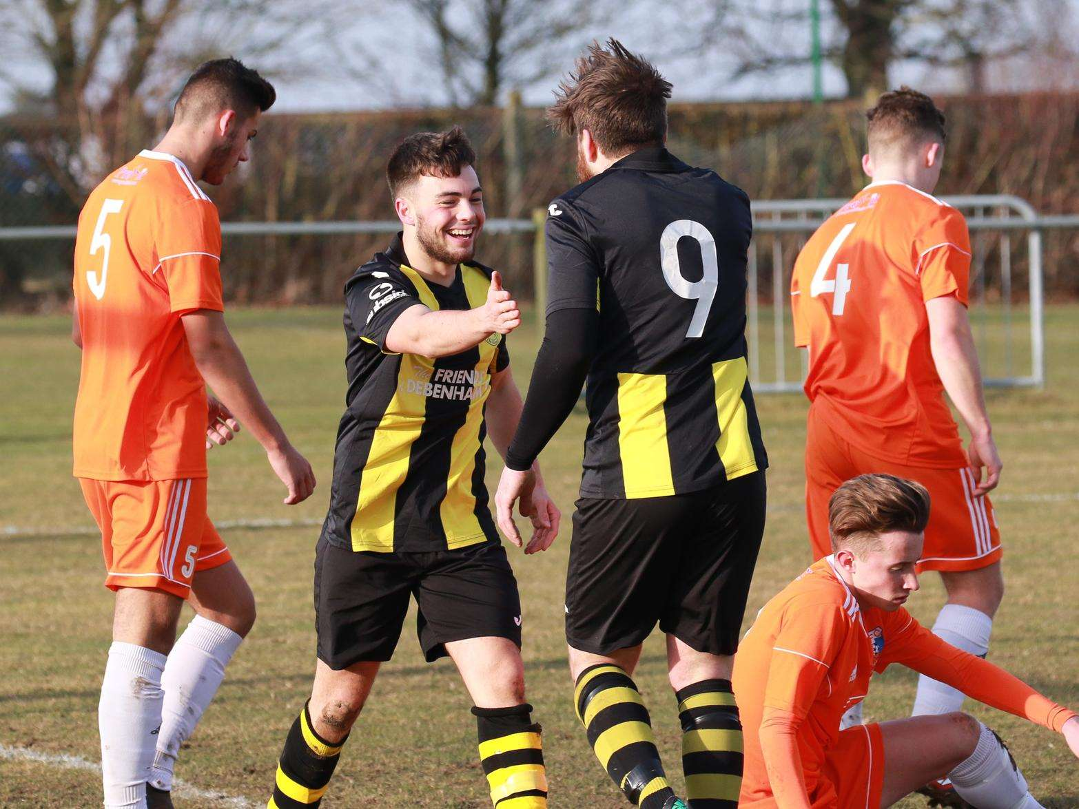 AT THE DOUBLE: Tanner Call celebrates with stirke partner Craig Jennings. Both players got braces in a 4-0 win Picture: Gary Donnison