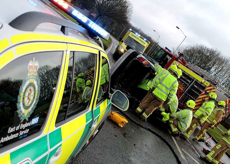 EEAST staff and firefighters at the scene of a road traffic collision
