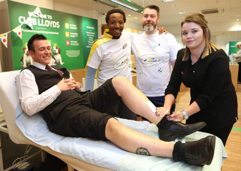 (L-R)Warren Winter - Branch Manager, Joe Buthelezi and Robert Kavanagh from Lloyds bank in Sudbury have their legs waxed by Grace Crimmin to raise money for Children in Need ANL-161118-165922009