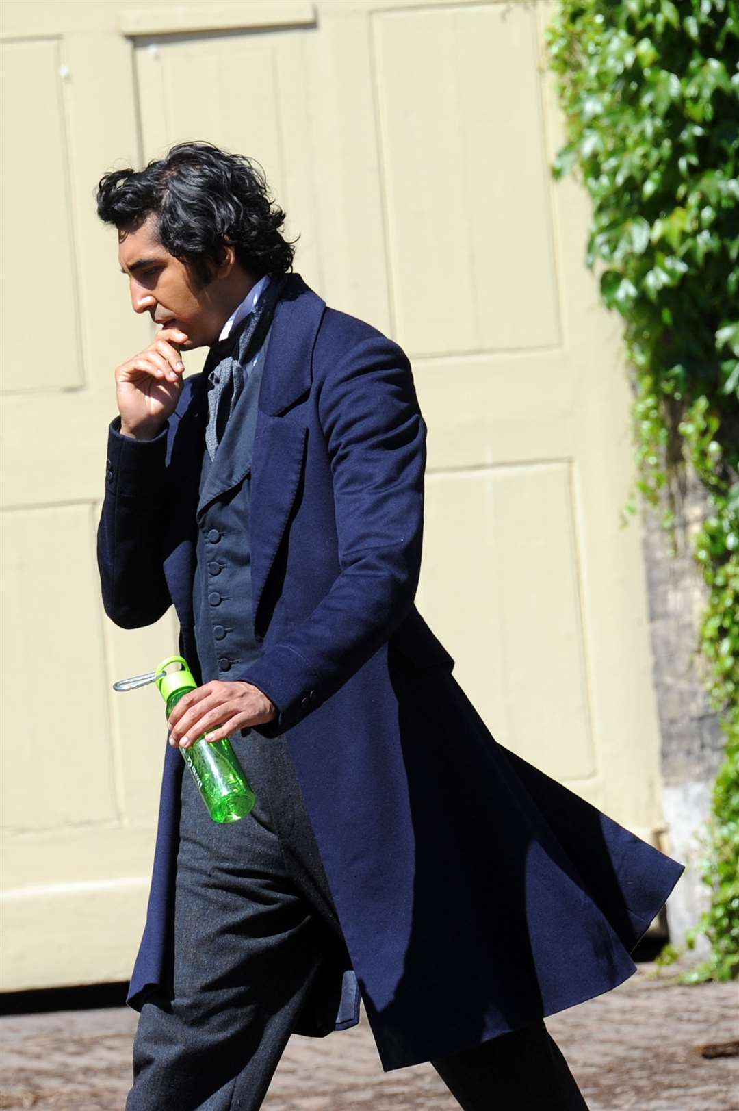 David Copperfield film shooting on Angel Hill, Bury St Edmunds..Pictured: Dev Patel as David Copperfield ... PICTURE: Mecha Morton.. (38968142)