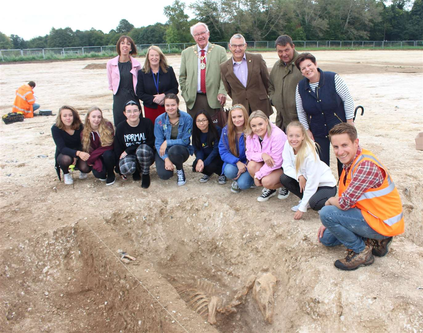 Dig project officer Rob Brooks, showing the skeleton of an Iron Age horse to Mildenhall Academy students, and principal Susan Byles with official visitors including Forest Heath councillors James Waters and Ruth Bowman