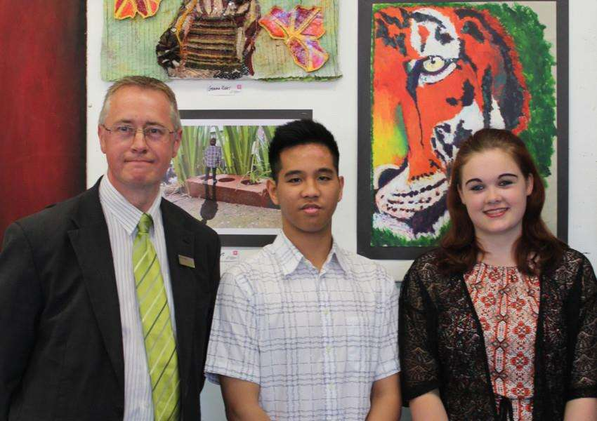 Two of the Waitrose Award winners Georgina Jackson Year 11 (pictured right) and Zach Domingo Year 11 ( pictured left) with Richard Bradford from Sudbury Waitrose. ANL-150715-152843001