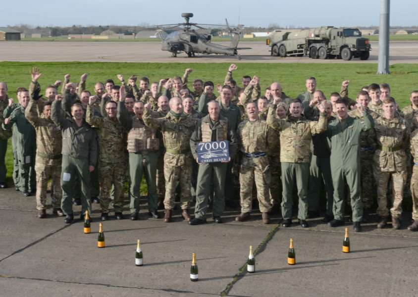 Army Air Corps Apache pilot Major Chris Hern MBE was given a rousing reception by colleagues at Wattisham Flying Station when he touched down after 7,000 hours flying. ''Photo: Corporal Andy Reddy RLC ANL-160119-150901001