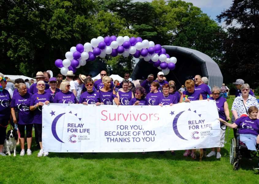 Cancer survivors and their supporters take part in the Cancer Research UK Relay for Life.'Pic - richard Marsham/RMG Photography