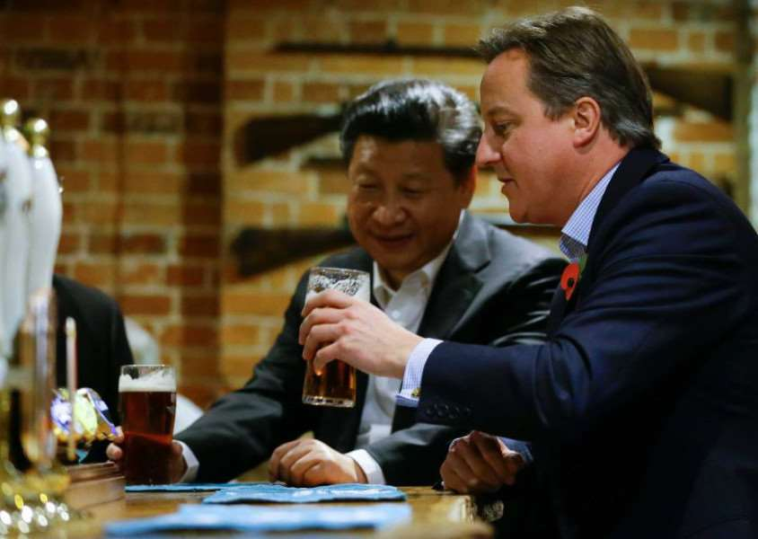 Premier Chinese Premier Xi Jinping and UK Prime Minister David Cameron enjoy a pint of Greene King IPA.