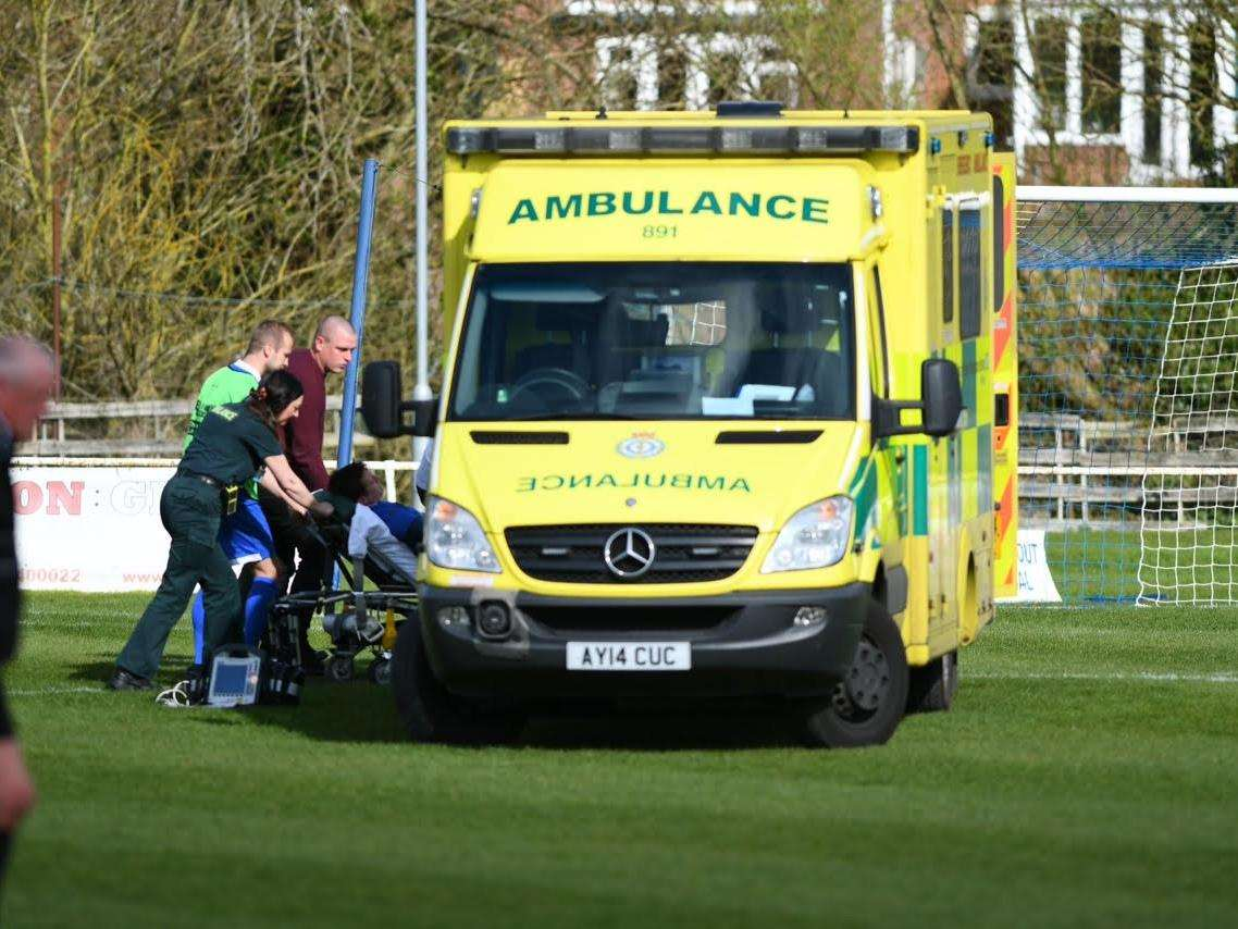 NASTY INCIDENT: Haverhill Borough defender Lee Hurkett is taken to hospital for treatment on a head injury.
